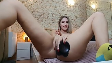 Blonde masturbating with BBC dildo while watching BBC porn