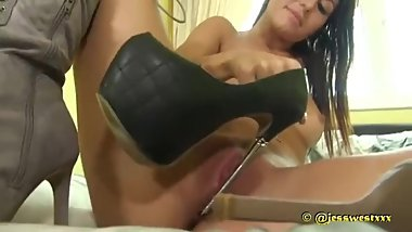 Rich Bitch pleases herself with her metal heels