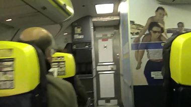 Naked blonde in the airplane masturbates in the bathroom