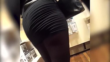 sexy blonde MILF in tight miniskirt exposes her big ass walking an shopping