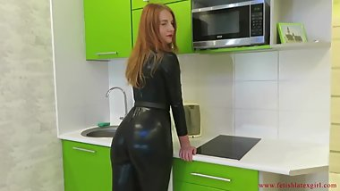 Redhead girl with big ass walks in tight suit and touches herself
